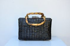 Vintage Black Wicker Bag Picnic Handbag with Wooden Handle *Lining inside is in great condition *One large compartment with one small side compartment *Tag is missing was removed *The handle is wood or bone not sure but beautiful *Outside has few scratches / paint is scratched off - two tiny straw parts are missing . Pretty normal for this kink of material and age ! As is , priced accordingly !     ***Excellent Vintage Condition !! ***    Measurements : 11 1/4 Long 13 3/4 Tall ...