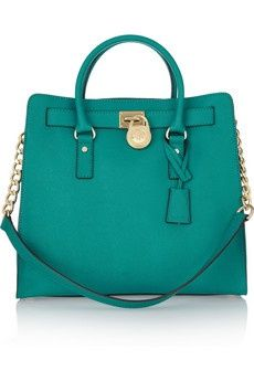 I can never resist stopping and trying on Michael Kors' bags in front of the  mirror to see how every color matches my outfit whenever I see them in a store. This bold turquoise tote is a super chic way to tap the tonal trend. Luxe gold hardware and subtle structure lend this leather piece polish.