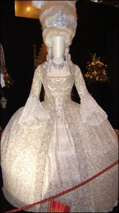 the dress is white with silver beading, gold embroidery and hanging pearls. The sheer amount of detail in this gown is incredible.