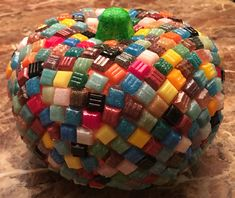 Dollar Tree Pumpkin covered with mosaic tiles. Dollar Tree Pumpkins, Altered Bottles, Mosaic Tiles, Halloween, Mosaic Pieces, Halloween Stuff