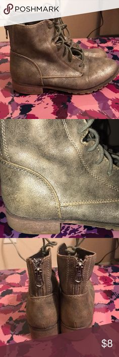 Combat boots Super cute metallic combat boots. Size 6.5. Scuffing on the inside of shoe and on toe (see pics) not really noticeable unless you are looking for it. Other than that comfy and in great condition Shoes Combat & Moto Boots