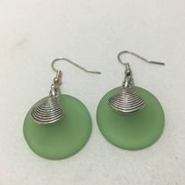 Green glass and shell charms dangle earrings. Made with silver plated non tarnish hypoallergenic nickel free materials.
