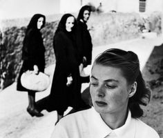 "Ingrid Bergman attracts curiosity of local women in the village where she is on location for the film ""Stromboli""."