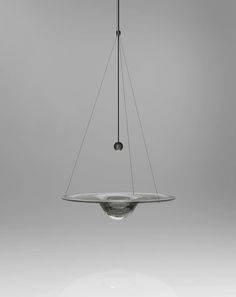 Momento - Nao Tamura.  There is a moment when molten glass transforms from…