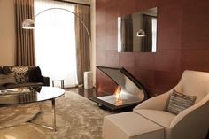 The high tech Zeta fireplace is made of leather, stainless steel and glass.
