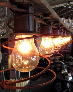 Rejuvenation Salvage Sighting: light fixtures made from antique bed springs