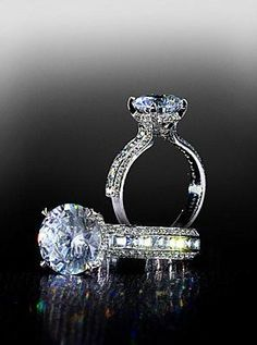 Stunning Blaze mounting with pave sides set with a round brilliant center diamond. By Bez Ambar.