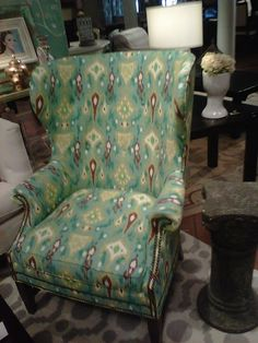 Robert Allen's Khanjali in peacock ikat on this wing chair. Hmmmm. I could cover my wing chair in this? Or make drapes, like they did on Young House Love (I think). Or just throw pillows? The brown in this ties in with the browns in the living room, which is adjoining.