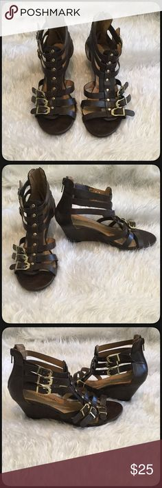 """🆕City Classified Brown Gladiator Wedges Cute brown faux leather gladiator style wedges by City Classified. Material is soft and they are textured like real leather. Pretty dark brown with buckles and adjustable straps. Gold studs and zipper on the back. Heel height 2.5"""". Worn for a day they were a little too big for my daughter. Like new, EUC. No box. Size 6.5M. Cityclassified Shoes Wedges"""