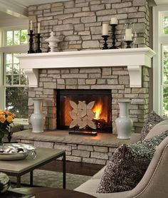 Attractive White Shelf Mantel On Natural Stone Fireplace Designs In Contemporary Lounge With Grey Sofa