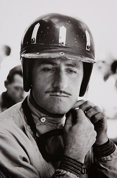 Graham Hill (1929-1975) - British racing driver and team owner from England, who was a two time Formula One World Champion. Photo by Walter Iooss