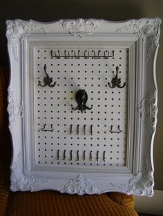 Put a frame around a piece of pegboard for a great jewelry holder. So doing this, but with a less ornate frame.
