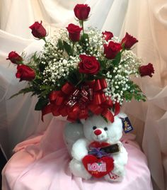 """The perfect way to say """"I Love You"""" to your Valentine! This package includes the traditional dozen roses (available in several colors) along with a cuddly soft teddy bear & a 6 piece truffle baton from Wiseman House chocolates. Flowers, Chocolates, & a Bear delivered with a personal card...."""