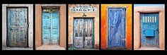 Decoration:12 x 36 inch panoramic photograph of a group of colorful blue Southwest Doors 1 This image shows a grouping of five doors that each have their own unique character showing their age ** Want additional info? Click on the image.