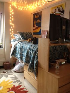 Interior Design Dorm Room...privacy idea....place desk and bookcase at the foot of the bed