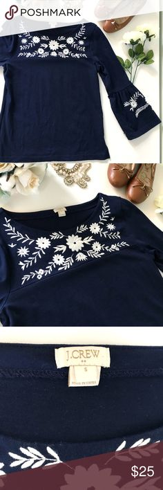 "J. Crew Factory Navy Embroidered Bell-Sleeved Top This is a gorgeous top from J. Crew Factory that features white floral embroidery and on-trend bell flare sleeves. In excellent used condition. It is 18"" across at the bust, 19"" across at the bottom hem (hips) and it is 24.5"" long. Hope you love your new blouse from J. Crew! J. Crew Factory Tops Tees - Long Sleeve"