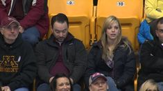 Guy Pulls Out Sign on Gophers Kiss Cam -- Great sign, truly ingenious.