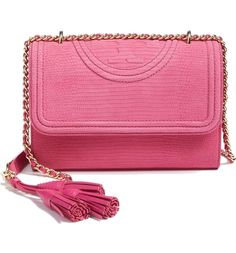 Snakeskin embossing lends an exotic flair to this pink compact shoulder bag by Tory Burch.