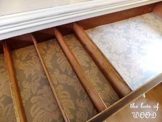 use wallpaper from hme depot inside unsightly drawers