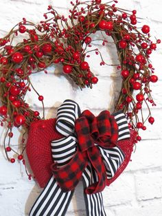 Valentine Wreath, Red Berry Heart Wreath, Valentine Decoration, Valentine Heart Wreath A garland of red mixed size berries adorns this heart-shaped grapevine wreath and a triple bow of red burlap, black and white stripe, and red and black buffalo check completes this Valentine/Winter