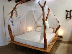 Love the bed canopy made of real tree trunks @istandarddesign