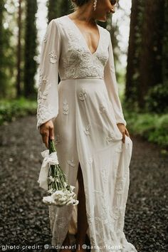 Long sleeves with subtle volume, a plunging neckline, and a sexy slit strike the perfect balance between bohemian romanc How To Dress For A Wedding, Luxury Wedding Dress, Bohemian Wedding Dresses, New Wedding Dresses, Elope Wedding, Bridal Dresses, Dream Wedding, Bridesmaid Dresses, Bohemian Weddings