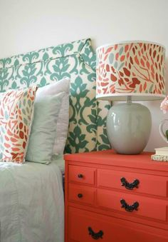 Orange and turquoise cole scheme. Bedroom, pillows, lamp