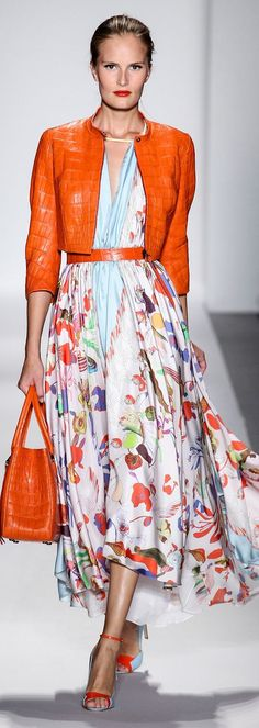 while this exact outfit would be a bit much for working in a conservative office, this orange, this kind of floral, and the idea of the cropped jacket over floral dress is great!