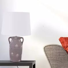 A lamp that sheds light on our past culture and trends with its classic lines and curved handles. This one has a lighter lampshade to give it a pastel hue that will blend into any surrounding. Luxury Lighting, Table Lamps, Sheds, Lighter, The Secret, Hue, Teak, Pastel, Glamour