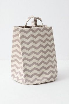 This chevron print basket in a subtle gray and white color combination would work well as extra storage in a small bath.