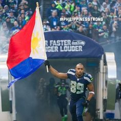 seattle seahawk players photos seattles times | Seattle Seahawks Doug Baldwin carries the Philippines flag in support ...