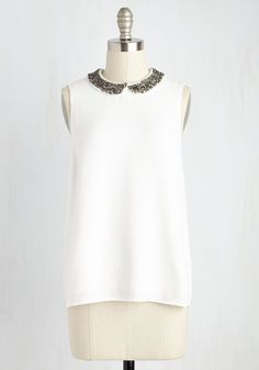 Demonstrate the brightness of your personality with the twinkling touches on this white top! You know that the crosshatch pewter sequins along the Peter Pan collar of this spunky-yet-sophisticated tank are all you need to externally exemplify your glittering charisma.