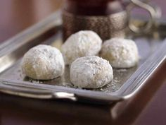 """Russian Tea Cakes (Mexican wedding cake)  *1c butter softened *1/2c powdered sugar *1tsp vanilla *2 1/4c all-purpose flour *3/4c fine chopped nuts *1/4tsp salt *Powdered sugar  ~Oven 400F~Mix butter, sugar  in bowl. Stir in flour, nuts  til dough holds together.  Shape in 1"""" balls. Place 1"""" apart on ungreased cookie sheet. Bake 10-12 mins,til set-not brown. Cool slightly on wire rack.  Roll warm cookies in powdered sugar; cool on wire rack completely. Roll in powdered sugar again."""