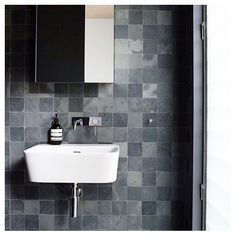 Square matte stone look tiles in this bathroom by Rachel Hudson Architect. Also features our Vivid Slimline Wall Set.