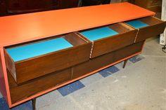 Tangerine on a walnut credenza mid century modern furniture