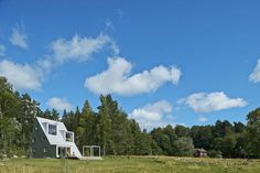 An A shaped summer house in  rural Sweden.  The home is made from reclaims materials and is very ecological.