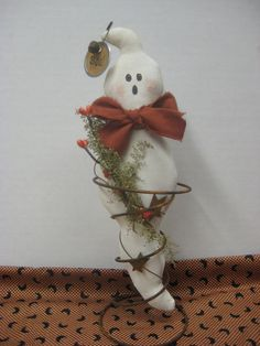 Prim Ghost in Rusty Spring - Halloween Decoration. $10.50, via Etsy.