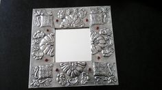Embossed Pewter Mirror