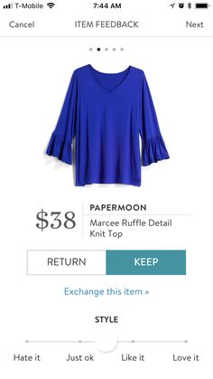 I LOVE the color on this. It's so bold and bright. Plus, the bell sleeves are fun, although I prefer full length sleeves.