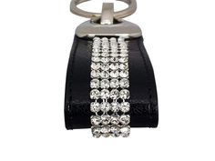 Black leather Cango & Rinaldi key ring with Swarovski crystals. With this key ring you will not lose your keys into your purse. Length 10,5 cm = 4.1 in Crystal length 4,0 cm = 1.6 in Wide 2,5 cm = 1.0 in