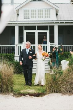 Charleston Weddings magazine Summer 2014 / photograph by Lindsey A. Miller Photography at The Cottages on Charleston Harbor / florals by Sara York Grimshaw Designs / bridal attire by Jenny Packham from @whiteondi