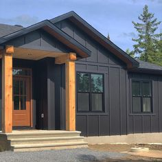 Dark Siding House, Black House Exterior, Exterior House Siding, Timber House, Exterior House Colors, Dark Grey Houses, Board And Batten Exterior, Farmhouse Paint Colors, Tiny House Cabin