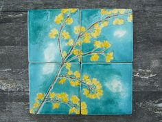 4 ceramic tiles yellow forsythia blossoms beautifully painted in turquoise crackle glaze sky, dreamy white clouds, kitchen, bathroom. £48.00, via Etsy.