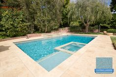 Enjoy the zen of Hydrazzo Cayman Lagoon in this soothing backyard pool.   Pool by Mission Pools of San Diego www.missionpools.com   www.clindustries.com