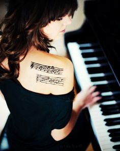 music tattoo: want something like this but the notes would be one of my favorite song and on my ribs.