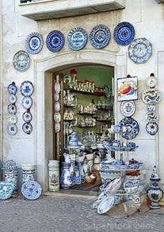 Throughout Portugal, beautifully decorated ceramic tiles, or azulejos, adorn the interior and exterior of buildings. Blue and white are predominant colors. Tiles and other pottery are sold in shops.