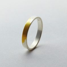 Torafu Architects - Gold Ring with Silver coating wears down over time to expose the Gold.