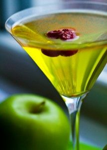 Spicy Appletini ~ vodka, sour apple schnapps, ginger ale, dash of cayenne, splash of lime juice, garnished with cranberries or maraschino cherries.