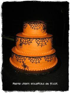 spider web design on an orange halloween cake.   NOTE: WHITE ICING  BLACK WEBS & PURPLE EDGING..
