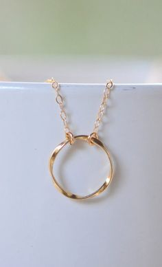 Simple Gold Circle Necklace.  Everyday Twisted Gold  I really love circle pendants - they remind me of karma, and help me to spread the positivity.